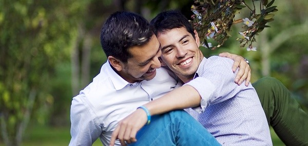 two gay men embracing