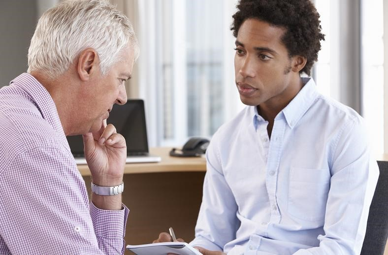man speaking with a social worker