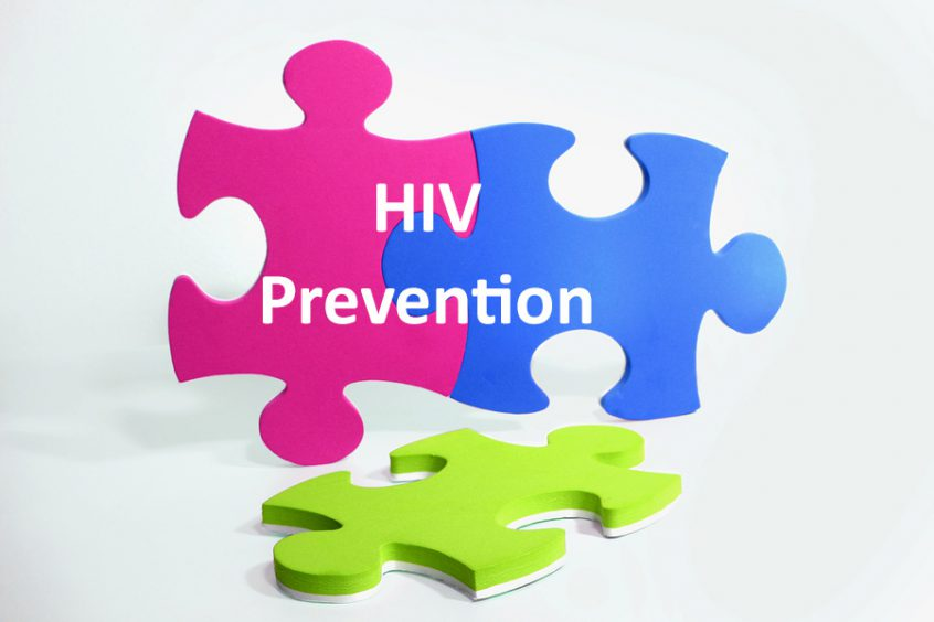 "The words ""HIV prevention"" super-imposed over three colorful puzzle pieces magenta blue and green"