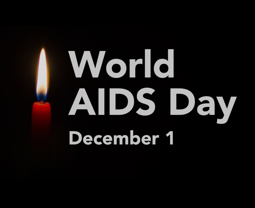 "Single red candle on a black background with the words ""World AIDS Day December 1"" in large white letters."