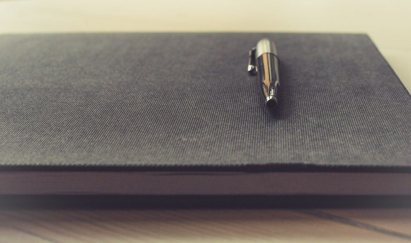 Image of pen and notebook
