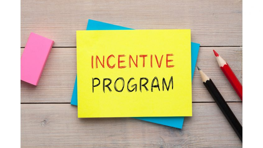 Incentive Program is written on a sticky note beside an eraser and two pencils