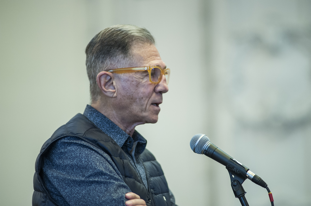 Ron Rosenes speaks into a microphone, during a QA.