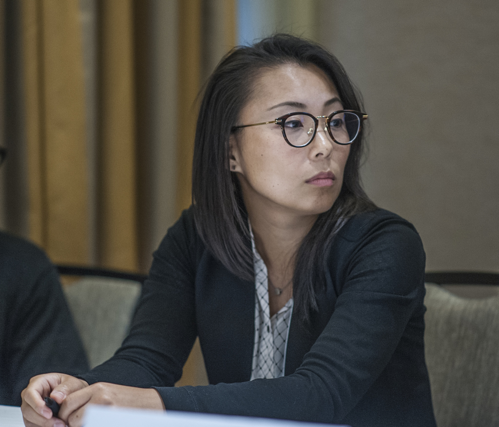 Connie Kim looks toward a fellow panelist during a breakout session.