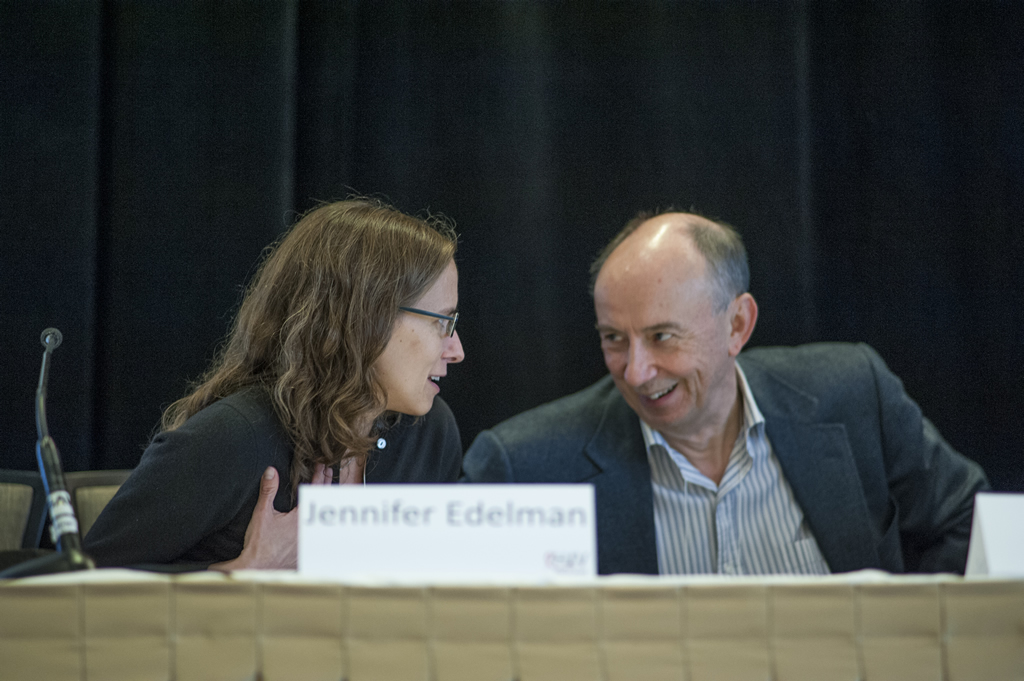 John Gill and Jennifer Edelman share a laugh at the speaker's table.