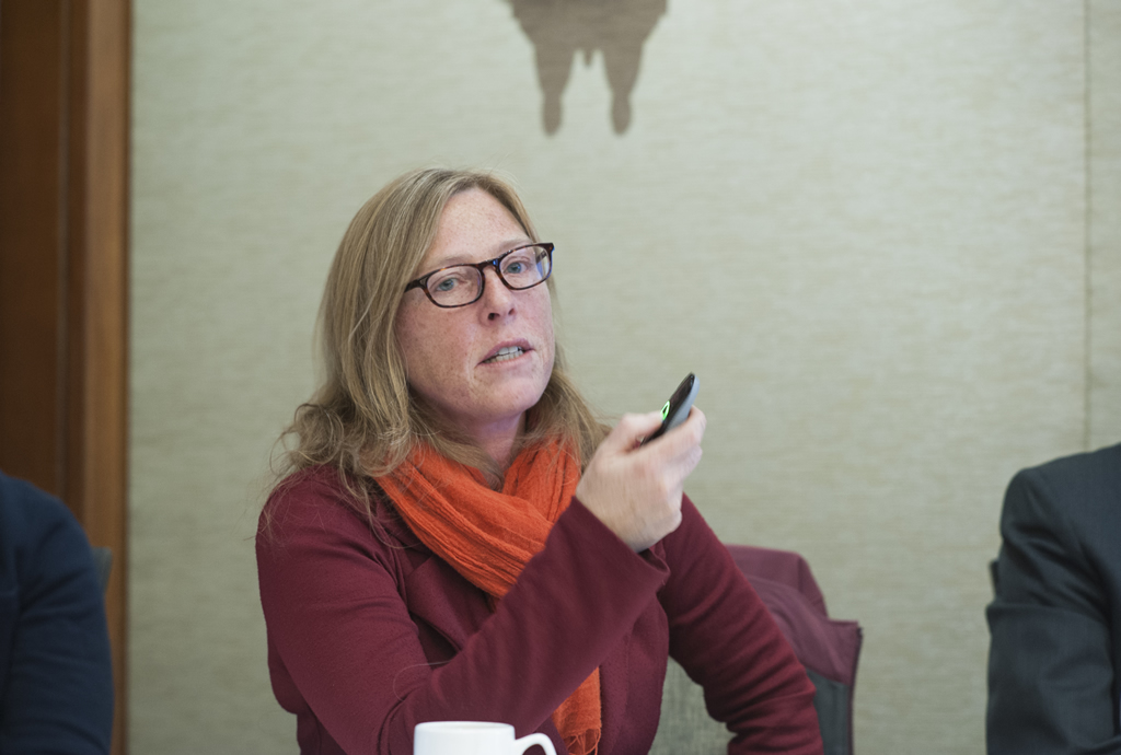 A panelist gestures with a pointer during a breakout session.