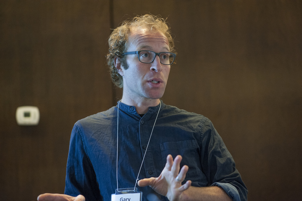 Gary Bloch gestures as he presents during a breakout session.