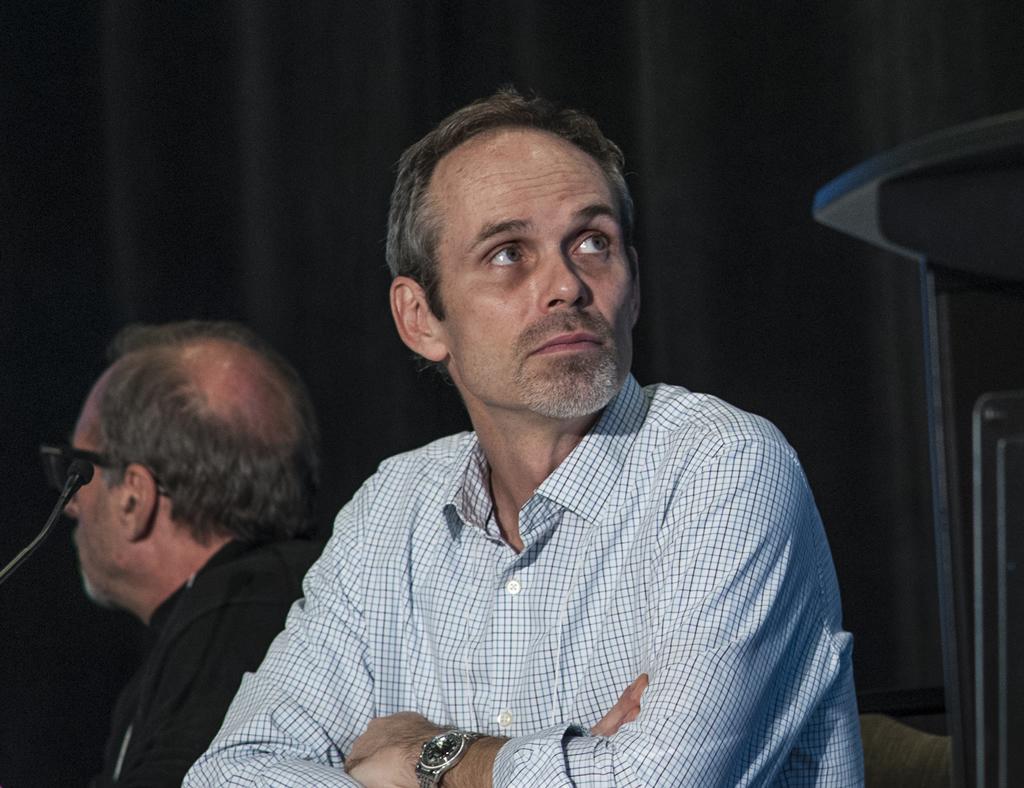 Rupert Kaul turns to watch Kashuba's presentation.