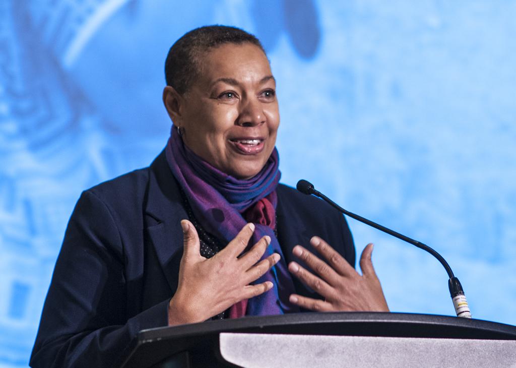 Alison Duke stands at teh speaker's podium.