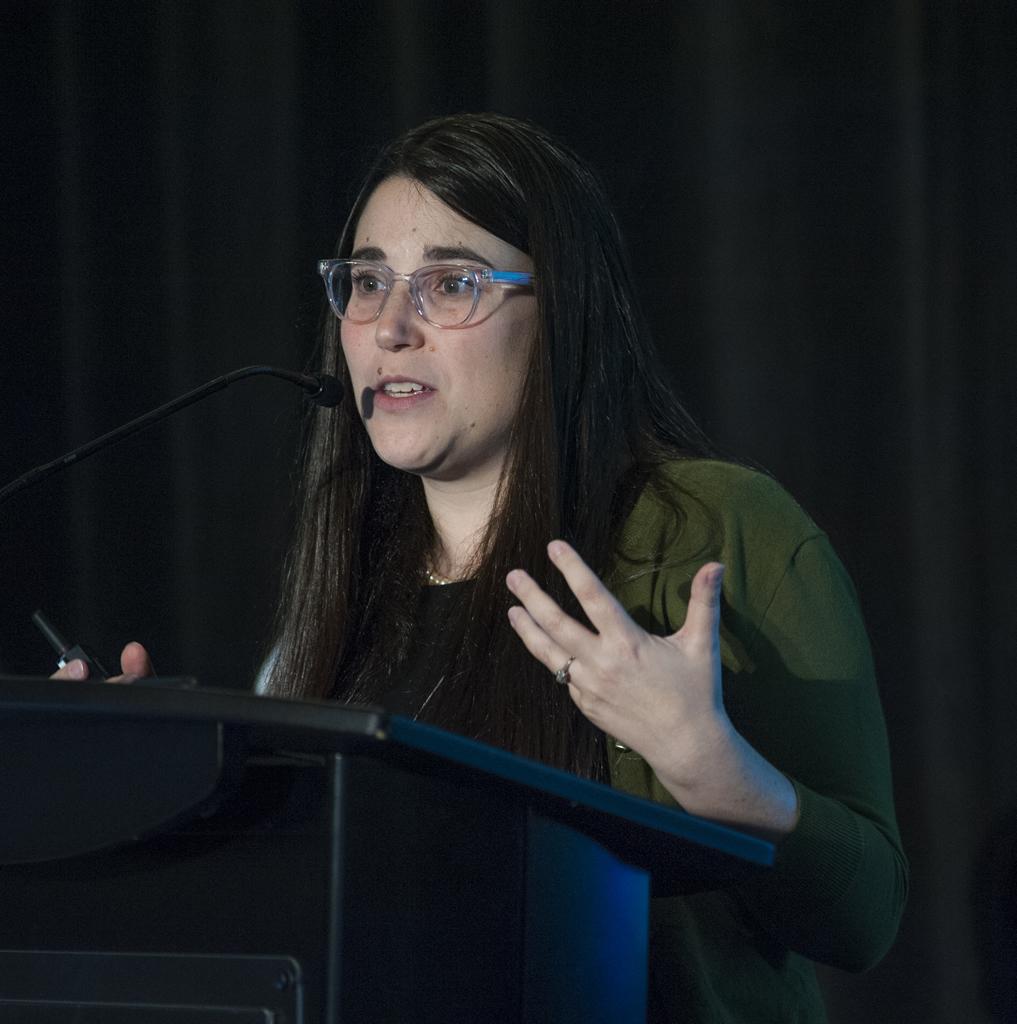 Jessica Merlin gestures during a presentation.