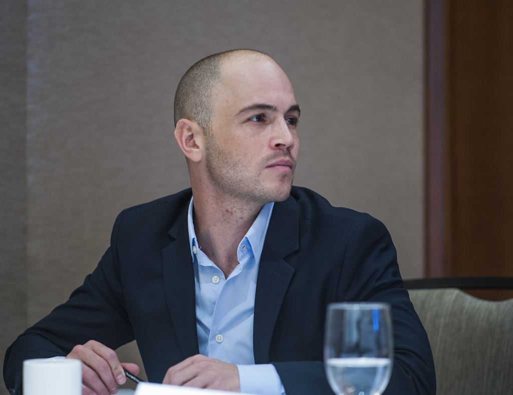 A panelist looks off camera toward another speaker during a breakout session.